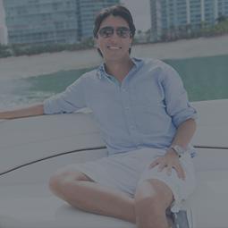 man sitting in boat smiling