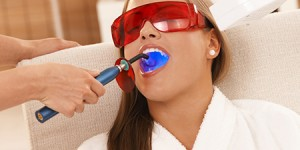 woman getting teeth whitened Dr. Joe Thomas Dentistry