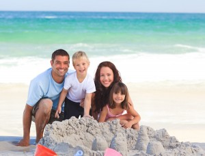 Family at the beach, Smiling, South Florida dentist