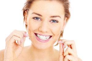 Flossing teeth, woman, smiling Dr. Joe Thomas Dentistry