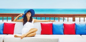 woman lounging on a couch by the ocean