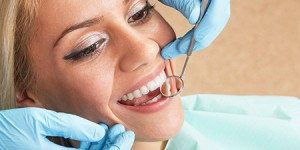 woman getting dental exam Dr. Joe Thomas Dentistry