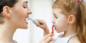 mother and child brushing teeth Dr. Joe Thomas Dentistry