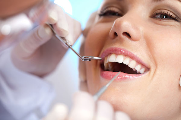 Woman smiling at dentist, Fort Lauderdale dentist