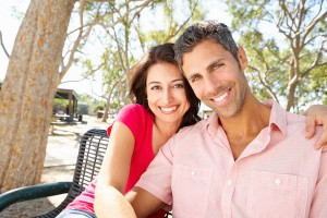 Couple Sitting on Bench, Dr. Joe Thomas Dentistry