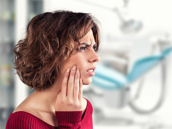 Girl with a painful tooth in a medical office Dr. Joe Thomas Dentistry